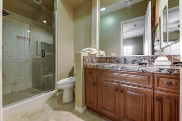 A full bathroom with a sink and tub/shower combo is located across the hall from Bedroom 5.