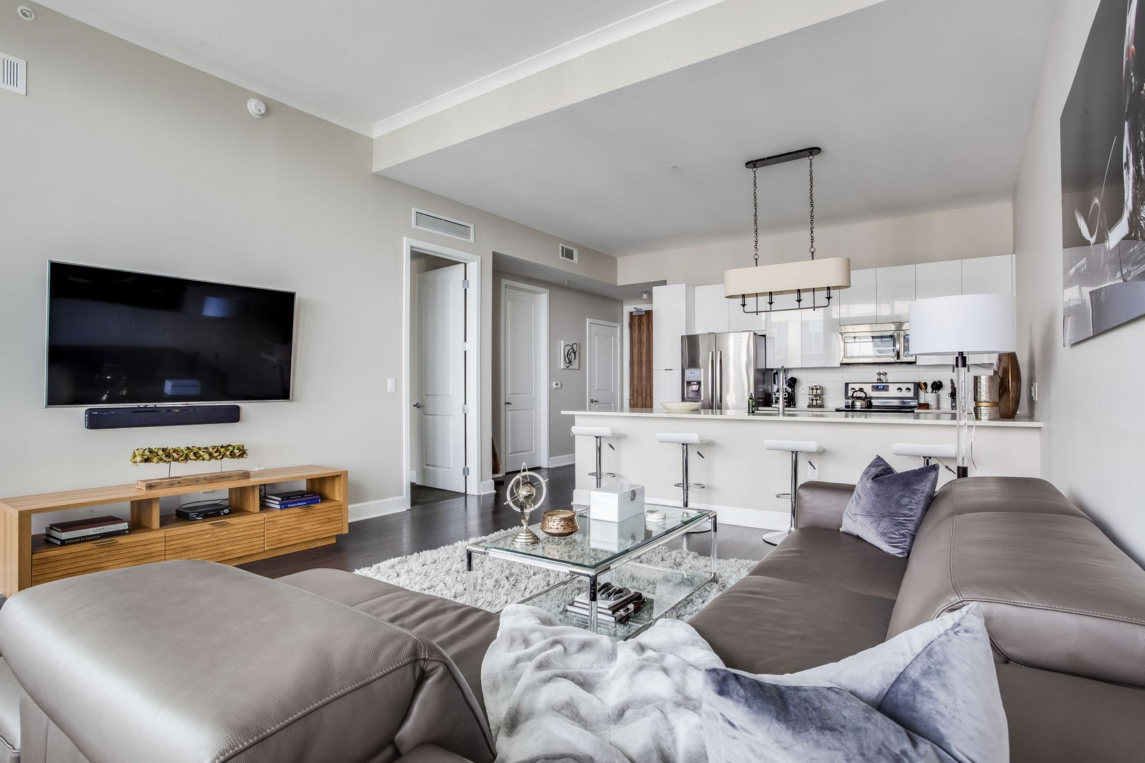 Living area with views of TV and kitchen