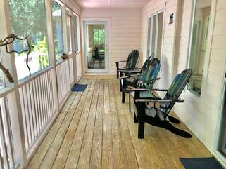 Screened porch accessed from family room and kitchen areas
