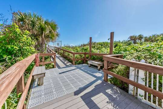Private boardwalk right to the beach with a shower