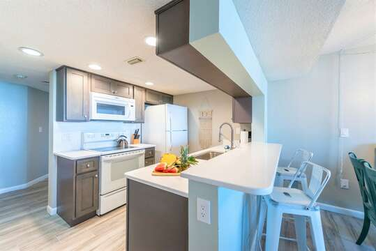 Fully renovated kitchen with storm grey cabinets & quartz counters