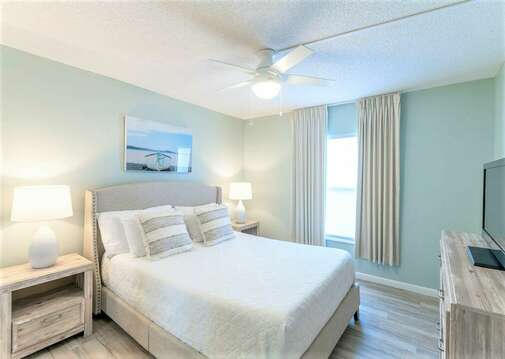 Comfortable guest bedroom with Queen bed, TV & closet