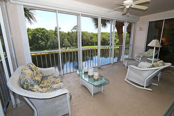 Relaxing screened in patio with a stunning view