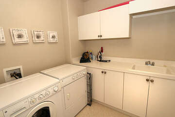 Sizable laundry room with utility sink and storage