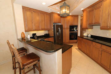 Sizable kitchen with tasteful bar seating