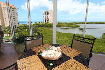 Enjoy dining on the large, well furnished screened terrace