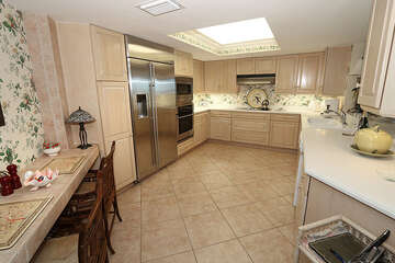 Sizable kitchen with gigantic refrigerator