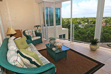 Guest bedrooms enjoy a separate screened balcony with backwater views