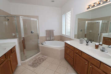 Expansive master bathroom with double sinks, walk in shower and garden tub