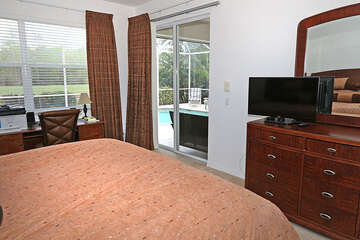 Master bedroom has great view and sliders out to the pool