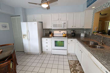 Renovated kitchen with Granite counters and beadboard cabinets.