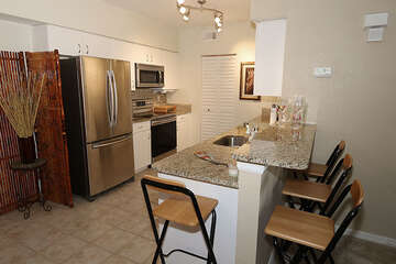 Wonderful stainless steal appliances and bar top seating