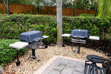 Convenient BBQ grills by the pool