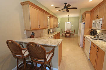 Large kitchen with bar top seating