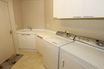 Large laundry room with utility sink and counter space for folding
