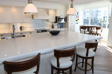 Gigantic kitchen island with bar seating