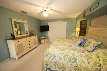 Master bedroom with king bed and TV, lanai access