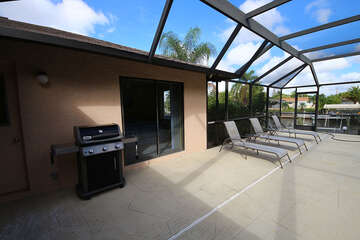 patio with loungers and grill