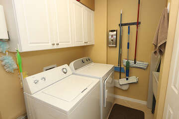 Private laundry room with washer and dryer