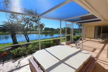 Large screened in lanai, with outdoor dining, grill, hot tub and views for lake golf course