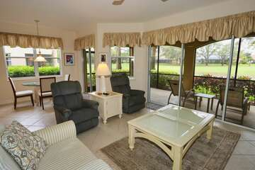 Living room with Golf Course Views and large screened lanai