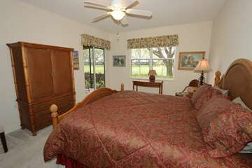 Master bedroom wiht king bed TV and lanai access