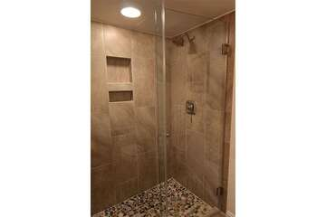 Step in shower makes easy access.