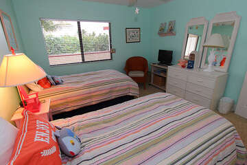 Guest bedroom is comfortable and offer natural light.
