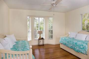 Guest bedroom 2 offers twin trundles.