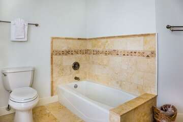 Master bath has a tub for those who love to soak in bubbles!