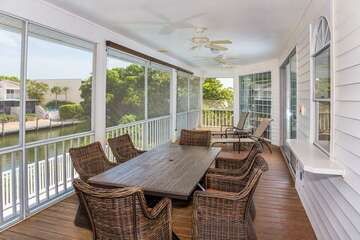 Screened upper level deck overlooking the canal.