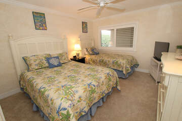 Guest bedroom offers lots of room and comfortable beds.