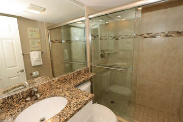 Guest bathroom with large walk in shower