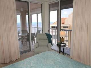 Master bedroom with access to the lanai and breathtaking views of the Gulf of Mexico.