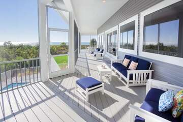 Large screened lanai located off the main living area on the upper deck.  Great for views of the Gulf and balmy breezes!