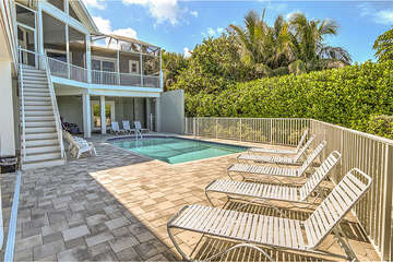 Large pool and patio area with loungers for those sun bathers!