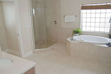 Elegant master bathroom is the perfect place to treat yourself to a bubble bath!