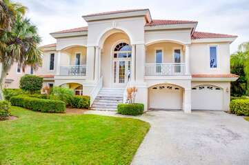Front view of this beautiful and majestic home located in one of the most desirable locations on Sanibel!