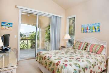 Guest bedroom with views of the outside.
