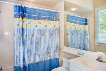Guest bathroom offers privacy for all.