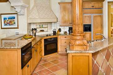 The kitchen has granite counter tops and custom cabinetry.