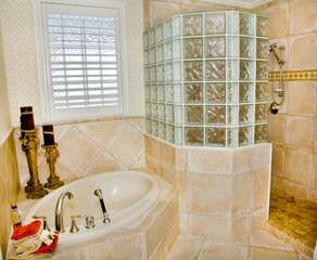 The master bedroom has French doors leading to a balcony and en-suite with 2 sinks, walk-in shower and garden tub.