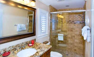 Guest Bathroom with a walk-in shower attached to the King Bedroom.
