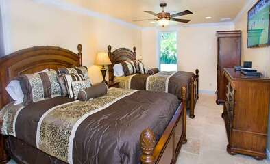Secluded lower level Queen bedroom which has 2 queen beds and a bathroom with a walk-in shower.