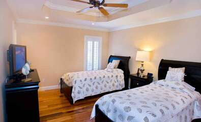 Charming Twin Bedroom with two Twin beds and a TV.