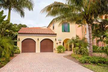 Beautiful furnished home with plantation shutters, wood and tile floors.