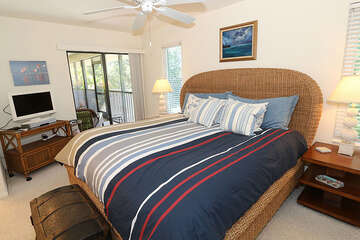 Master bedroom with king bed and lanai access.