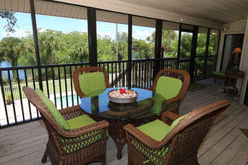 Screen lanai with outdoor dining.