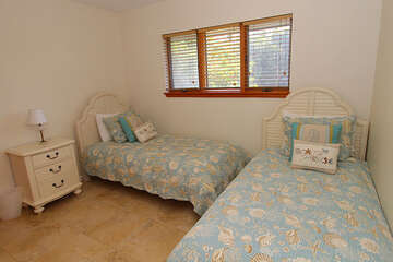 The second guest bedroom offers two twin beds. Both bedrooms share a full bathroom.