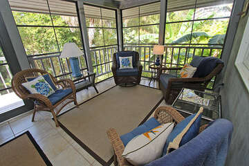 The house also offers a large screened in porch with outdoor seating, free wi-fi, total of four TV's and outdoor shower.